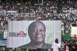 Bedie, seen here in a poster at an opposition rally, has called for civil disobedience against Ouattara's third term.  By SIA KAMBOU (AFP/File)