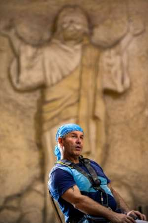Besides sculpting, Mario gives a High Ropes sport course at the monastery.  By Mohamed el-Shahed (AFP)
