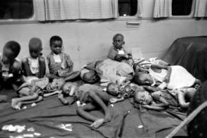 Biafran children sit in a plane chartered by the International Red Cross (ICRC) and humanitarian organisation