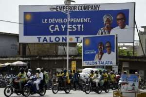 Billboards for Talon and his running mate were up around the economic capital Cotonou.  By PIUS UTOMI EKPEI (AFP)