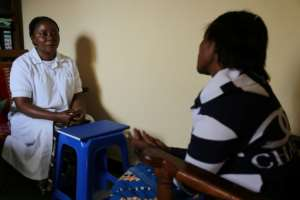 Both Tania, right, and her daughter Sofia (not their real names) fell pregnant after they were gang-raped. Tania is shown here speaking to a psychologist.  By SAMIR TOUNSI (AFP)