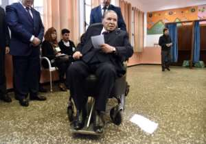 Bouteflika votes in local elections in November 2017. By RYAD KRAMDI (AFP/File)