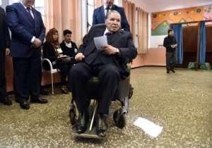 Bouteflika votes in local elections in November 2017.  By RYAD KRAMDI (AFP/File)