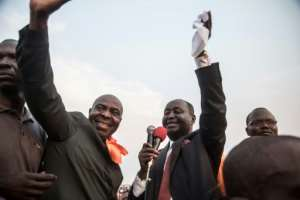 Bozize (L) briefly addressed the crowd that had turned out to welcome him.  By FLORENT VERGNES (AFP)