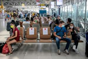 Blocked out seats ensure travellers observe social distancing rules at Suvarnabhumi Airport in Bangkok.  By Jack TAYLOR (AFP)