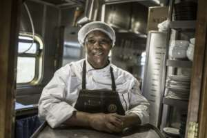 Blue Train staff like head chef Esther Ndhlovu put together menus of three to five courses along with wine pairings for the passengers.  By MARCO LONGARI (AFP)