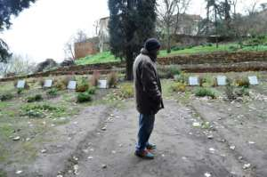 Brother Bruno stands near the graves of seven French Trappist monks at the Tibhirine monastery.  By RYAD KRAMDI (AFP)