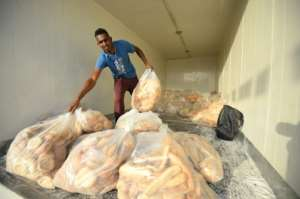 Bread is unloaded for distribution to protesters breaking the daytime Ramadan fast outside army headquarters in Khartoum. By MOHAMED EL-SHAHED (AFP/File)