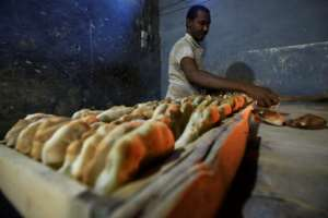 Bread is now so plentiful that there is a surplus in Atbara, residents say.  By ASHRAF SHAZLY (AFP)
