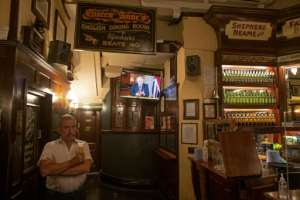 Britain's Prime Minister Boris Johnson has ordered pubs to close early to help stem the virus spread.  By JUSTIN TALLIS (AFP)