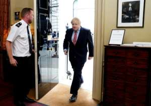 Britain's Prime Minister Boris Johnson spent a week in hospital with the virus. By Andrew PARSONS (10 Downing Street/AFP)