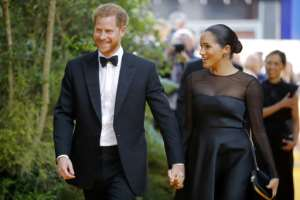 Britain's Prince Harry and his wife Meghan will be on their first official tour as a family.  By Tolga AKMEN (AFP/File)