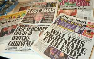 British newspaper headlines lamented tighter restrictions over the Christmas holidays.  By Paul ELLIS (AFP)