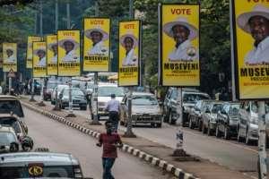 Bright yellow posters for incumbent Yoweri Museveni are everywhere in Uganda's capital Kampala.  By SUMY SADURNI (AFP/File)