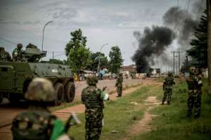 Burundian peacekeepers of the African-led International Support Mission to the Central African Republic (MISCA) patrol near a barricade of burning tyres in the Bea-Rex district of Bangui.  By MARCO LONGARI (AFP/File)