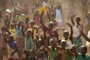Burkinabe children, waving at French troops passing by in armoured personnel carriers.  By MICHELE CATTANI (AFP)