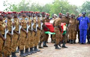 Burkinabe troops, seen attending the funeral of soldiers killed by jihadist groups in 2016, have made dozens of arrests in a sweep of violence-hit regions since the end of last year.  By AHMED OUOBA (AFP/File)