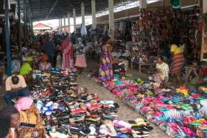 Bustling markets remain open.  By Tchandrou Nitanga (AFP)