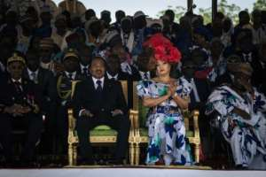 Cameroonian President Paul Biya, pictured here with his wife in 2018, has ruled for nearly four decades.  By ALEXIS HUGUET (AFP)