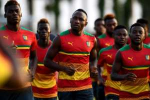 Cameroon's players run during a training session in Libreville on February 4, 2017, on the eve of the 2017 Africa Cup of Nations final against Egypt