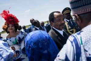 Cameroon's President Paul Biya (C, pictured November 2018) is