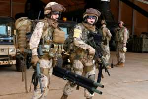 Canadian troops at a base in Gao, Mali, prepare to move out on a UN peacekeeping.  By SEYLLOU (AFP/File)