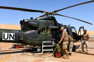Canadian UN peacekeeping soldiers work on an helicopter at the Castors Camp in Gao, Mali.  By SEYLLOU (AFP/File)
