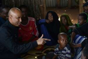 Canadian Immigration Minister Ahmed Hussen (L, pictured September 2017) said Canada is taking steps to resettle 750 ex-slaves from Libya, as well as 100 refugees from Niger.  By TONY KARUMBA (AFP/File)