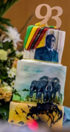 Cake designs included his official Mercedes-Benz limousine, a crocodile, the national flag, his own head and the African continent.  By Jekesai NJIKIZANA (AFP/File)