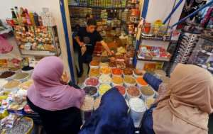 Cash-strapped Libyans shop at Tripoli's Souk al-Hout market ahead of Ramadan but many say their heart is not into it as the country is hit by new violence.  By Mahmud TURKIA (AFP)