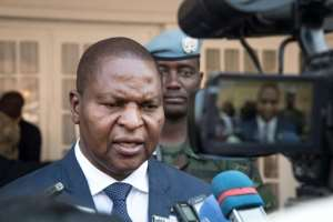 Central African Republic president Faustin-Archange Touadera signs a peace agreement reached in Khartoum earlier this month with armed groups controlling most of the country's territory.  By ASHRAF SHAZLY (AFP/File)