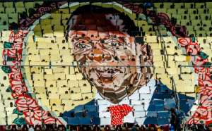 Changing times: Mugabe's portrait was once ubiquitous. But on Zimbabwe's Independence Day in April, it was the face of his successor, Emmerson Mnangagwa, which dominated.  By Jekesai NJIKIZANA (AFP)