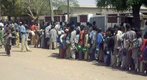 Child beggars queue for food in a rich neighbourhood of Kano.  By AMINU ABUBAKAR (AFP/File)