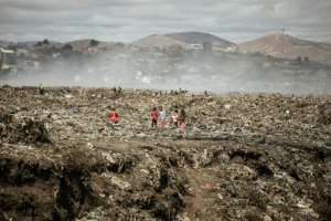 Children and waste pickers sift through garbage at a landfill near 'Cite Akamasoa' - 'Akamasoa Town'.  By GIANLUIGI GUERCIA (AFP)