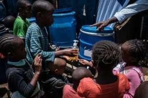 Children in the notorious Nairobia slum of Kibera learn how to wash hands to help prevent coronavirus.  By Yasuyoshi CHIBA (AFP)