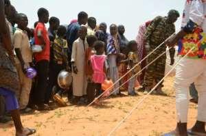 Children line up for food at the Saguia camp.  By BOUREIMA HAMA (AFP/File)
