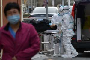 China, where the virus first emerged in late 2019, has largely eliminated its outbreak, but recent weeks have seen a smattering of cases.  By GREG BAKER (AFP)
