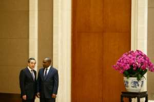 Chinese Foreign Minister Wang Yi (L with Alpha Barry) said Burkina Faso had 'made the right political decision'.  By THOMAS PETER (POOL/AFP)