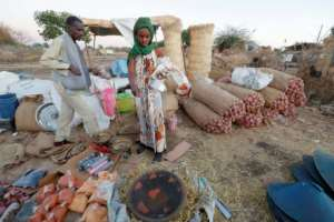 Christmas is a key religious festival for many Ethiopians, and refugees in Sudan on Wednesday bought up supplies to mark the holiday.  By ASHRAF SHAZLY (AFP)