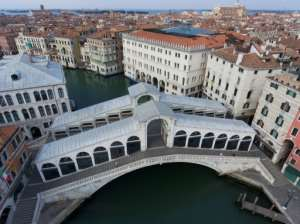 Cities like Venice went into full lockdown in April as half of humanity faced virus restrictions. By MARCO SABADIN (AFP)