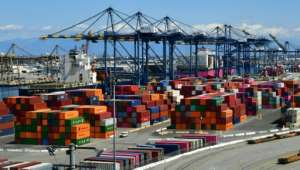 Containers are seen at the Port of Los Angeles on March 26, 2020 as the economy faces severe pressure from the coronavirus.  By Frederic J. BROWN (AFP)