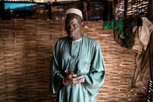 Conflict victim: Mamadou Lamine shares a makeshift house in Kaour with 11 other displaced people.  By JOHN WESSELS (AFP)
