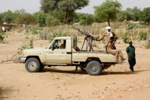 Conflict in Sudan's Darfur left the vast western region awash with weapons and divided by bitter rivalries; this 2006 photograph shows Sudanese security forces deploying during a rally.  By ASHRAF SHAZLY (AFP/File)