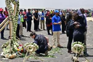 Colleagues of victims of the UN's World Food Programme office in Addis Ababa hugged in grief as they visited the crash site. The UN lost 22 staffers on the flight. By TONY KARUMBA (AFP)