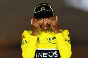 Colombia's Egan Bernal on the Tour de France podium last July in his Ineos yellow jersey.  By Marco Bertorello (AFP/File)