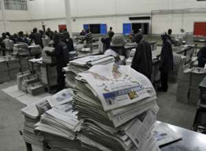 Copies of the China Daily fresh off the printing press pile up before distribution in the Kenyan capital, Nairobi, in this January 3, 2013 file picture.  By TONY KARUMBA (AFP/File)