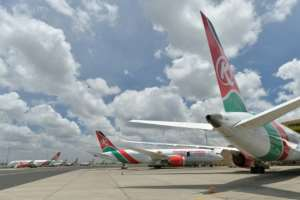 Covid casualty: Grounded Kenyan Airways planes at Nairobi airport last April.  By TONY KARUMBA (AFP)