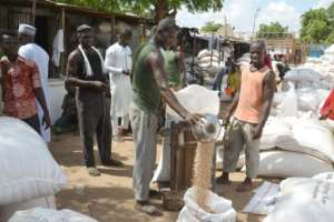 Cowpeas, a local staple, are weighed at Maradi's cereal market. Prices have fallen since Nigeria closed the border since August 20 to stop smuggling.  By BOUREIMA HAMA (AFP)