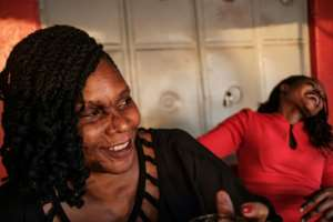 Close friends Reenah Ntoreinwe, pictured left, and Linette Kirungi, right, met each other as acid attack survivors.  By SUMY SADURNI (AFP)