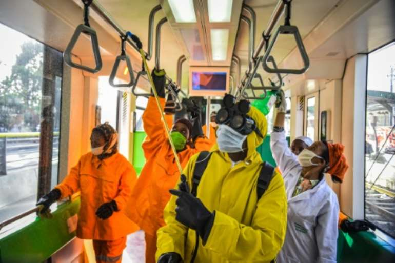 Cleaning staff disinfect a metro carriage in Addis Ababa- Ethiopia announced its first COVID-19 deaths Sunday. By Michael Tewelde